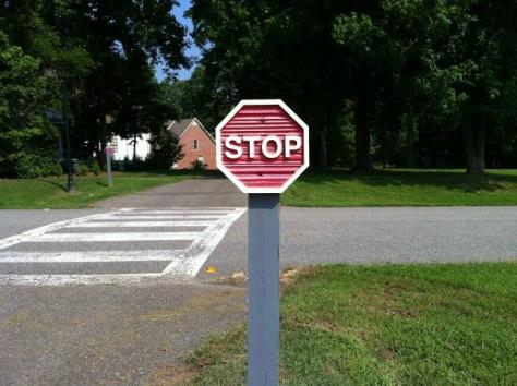 From Rene S: mini stop sign on a walking path!